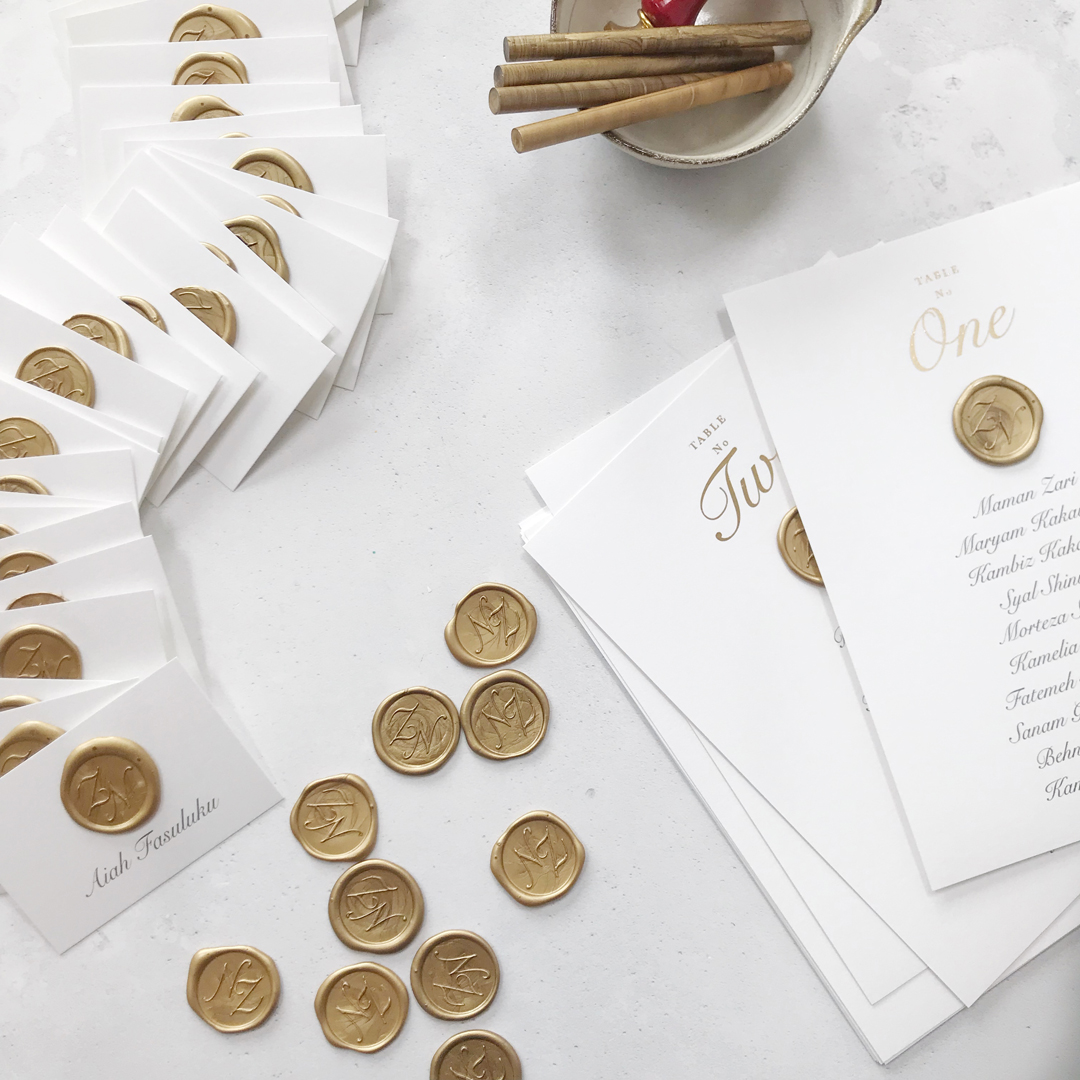 luxury-wedding-stationery-place-cards-gold-wax-seals